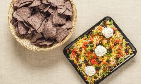 Taco Bean Dip with Chips in a Basket